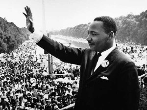 Rev. Dr. Martin Luther King Jr. waves to a crowd in front of the Washington Memorial, in Washington, DC