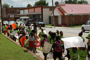 Freedom School scholars march down Reynolds Avenue to call attention to potential effects of an impending railyard facility.